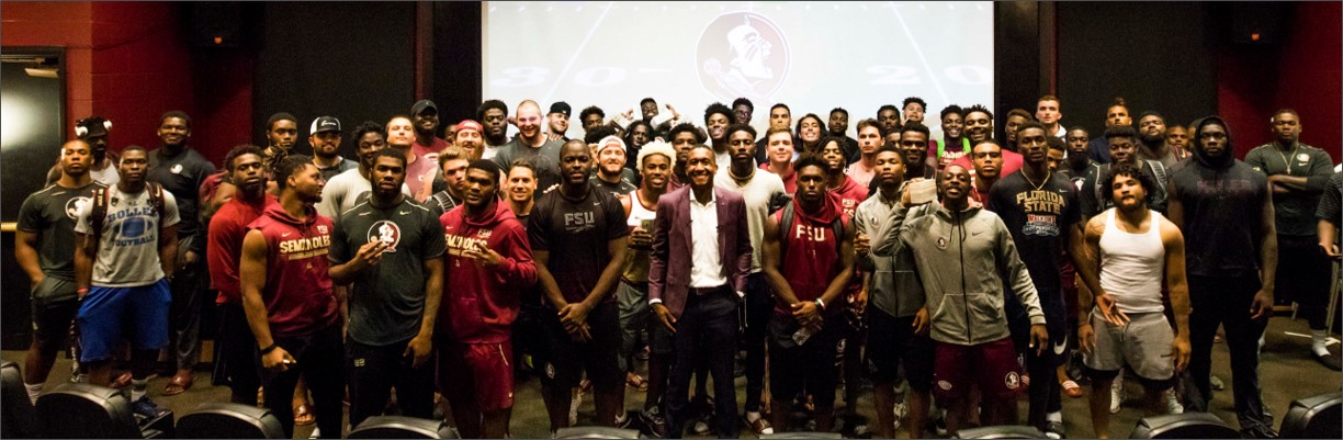 Didier with FSU Football team